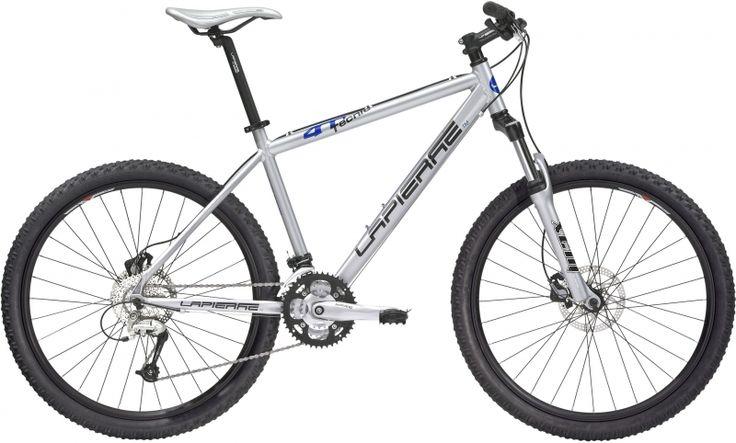 #Location #vélo cadre taille M rigide Freins à disques hydrauliques Shimano 160 mm Roues 26 pouces Fourche Rock Shox suspendue et blocable. Disponible sur www.placedelaloc.com