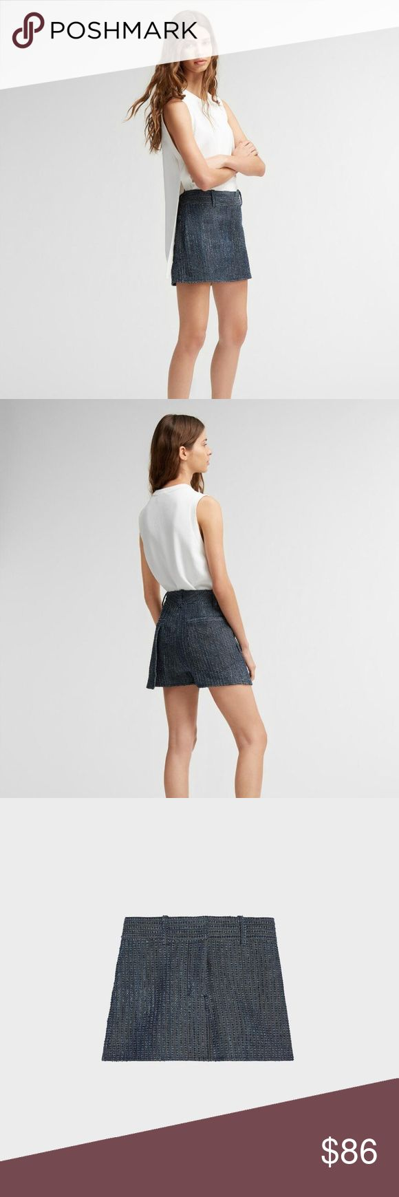 DKNY PURE PERFORATED TEXTURED DARK DENIM SKORT $198 NWT DKNY PURE PERFORATED TEXTURED DENIM SKORT  SIZE: sz 4 COLOR: Indigo / dark blue  BRAND NEW WITH TAGS MEASUREMENTS IN PHOTOS  A textured denim short with skirt overlay ideal for giving your spring uniform a modern, graphic update Front skirt overlay belt loops Inside hook & bar closure Side seam pockets Origin: Imported 401 Natural (Vegetable)->Cotton DKNY PURE Perforated Denim Skort from DKNY. DKNY Shorts Skorts