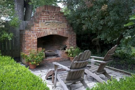 A large brick fireplace and a small patio form a cozy corner in this Ohio yard. More beautiful backyards: http://www.midwestliving.com/garden/ideas/30-beautiful-backyards/page/21/0