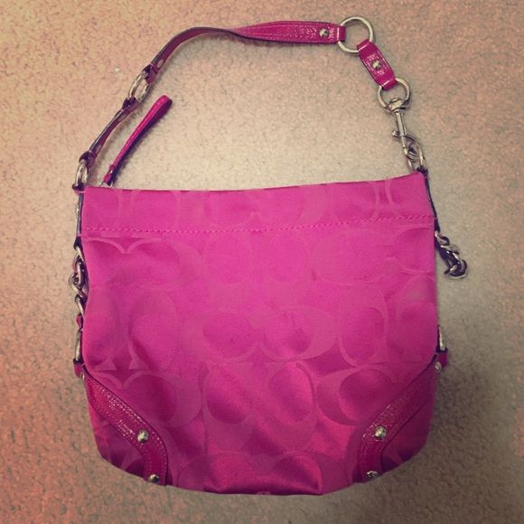Pink Coach Purse Cloth with leather trim. One side chain link is broke but just for show, little wear and tear, inside with zipper pocket and two side pockets, 12 inches wide by 8 inches wide. 8 inch shoulder strap more of a carry bag. Overall decent shape. Coach Bags