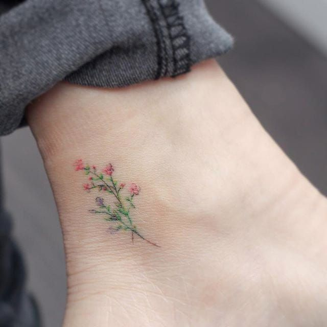Subtle tattoo by Mini Lau. subtle microtattoo pastel southkorean feminine girly tiny flower MiniLau
