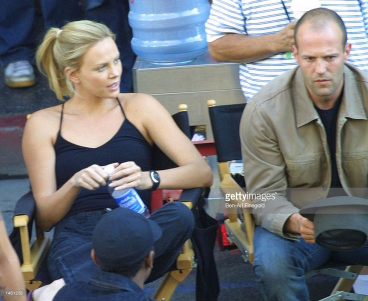 Actor Jason Stathem and actress Charlize Theron relax on the set of the 'Italian Job' on October 5, 2002 in Hollywood, California.