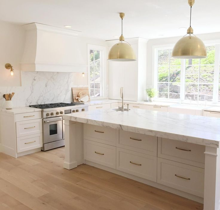 White, brass and marble kitchen