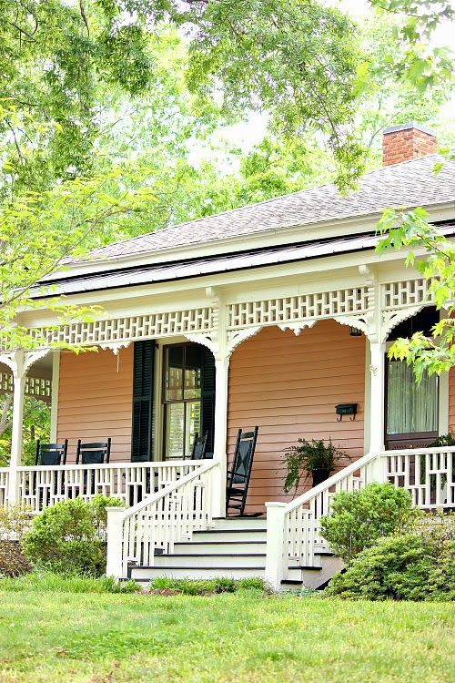 I can't resist a pink cottage, with black shutters and rockers with creamy white gingerbread accents.