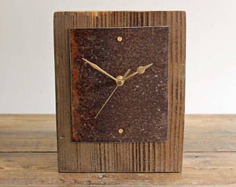 This one of a kind mantel clock or desk clock has been handmade in Norfolk England.  The wooden body of the clock has been cut from a piece of driftwood discovered along the beautiful local coastline, it has been cleaned and lightly sanded to retain the character. The face has been made from a piece of rusty beach metal which has a beautiful natural patina. It is held in place with brass screws. There is a felt base to protect any surfaces this is placed on, and a hand stamped copper…