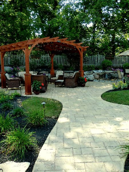 Stamped Concrete Patio with Pergola and Pondless Water Feature