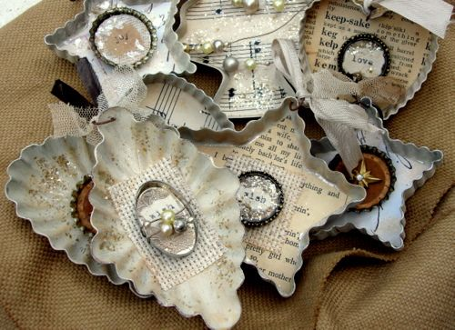 These are made from old cookie cutters with bits of beads, paper, and old bottle caps. Gorgeous, elegant, and re-using stuff from the craft and junk drawer. Love it!