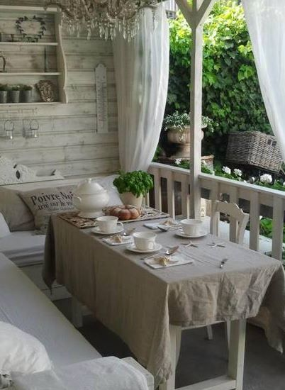 Summer house with white finish lends lightness to a dark garden ________ Ana Rosa: