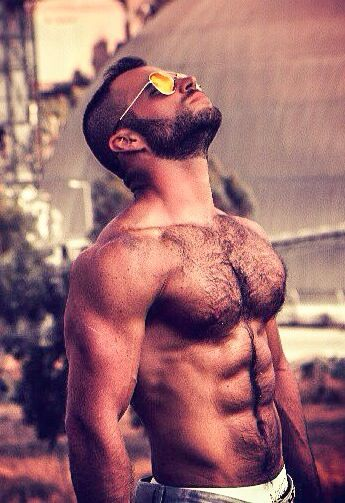 Masculine hairy pecs, stomach and face.