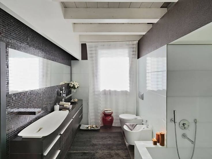 The black cut glass mosaic on the bathroom back splash shows the intricacy and vividness of this bathroom design despite the simplicity of the entire look. The dark wood vanity counter makes a more muted statement.