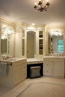 His and hers vanity spaces with a make-up station in the corner - great use of space! And those mirror lights!