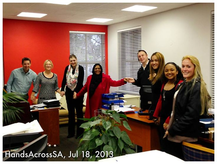 Some of our team with their hands across SA for Madiba's special day.