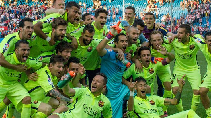 Barcelona players celebrate winning the 2014/15 Spanish championship