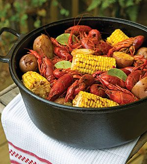 Fill a large stockpot with approximately 15 quarts water. Add salt, pepper, crawfish boil, garlic, cayenne, and bay leaves; bring to a boil over high heat. Reduce to a simmer; cook for 20 minutes.