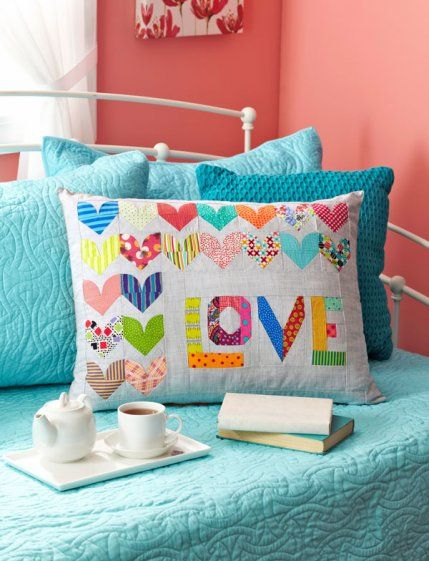 """I like the word """"love"""" on this pillow.  From: American Patchwork & Quilting February 2014 issue."""