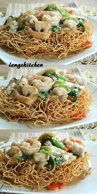 SEAFOOD BIRD'S NEST: 7oz fresh chow mein, 1 squid, 10 skinned & deveined shrimp, 12 bay scallops, 3 pcs tofu {or other kind} fish cakes, 1 pc chicken breast - excess fat trimmed, 1 handful rinsed & drained choy sum - Chinese mustard green, 1 med carrot, 2 eggs, 8 minced garlic cloves, 3 T cooking oil + some for deep frying • CHICKEN MARINADE: Few dashes white pepper, 1½ t light soy sauce, ¼ t sesame oil, 1 t corn starch • See 1st Comment for further Ingredients, & See Page for Directions!