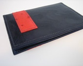 Midnight blue and coral red ostrich printed leather passport cover.  Do I really need to say anymore more?