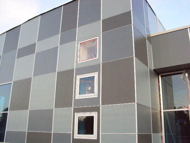 Modern cement board siding low cost housing pinterest for Modern fiber cement siding