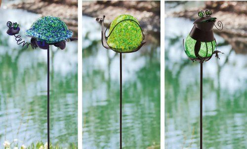 Glow In the Dark Garden Stakes - set of 3 by Outdoor Decor. $56.24. Made of metal and glass. set of 3 garden stakes. 22 inches tall. Great for yourself or as a gift. These stakes glow in the dark!. Add these artfully designed garden stakes to your outdoor space for a unique and stunning piece of décor. Made of durable metal and colorful glass, these garden stakes will reveal your passion for nature to passersby as well as add a charming accent piece to any lawn or garden. The ...