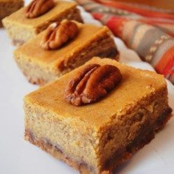 These pumpkin cheesecake squares have a delicious crust, a layer of cheesecake, and a layer of pumpkin pie.