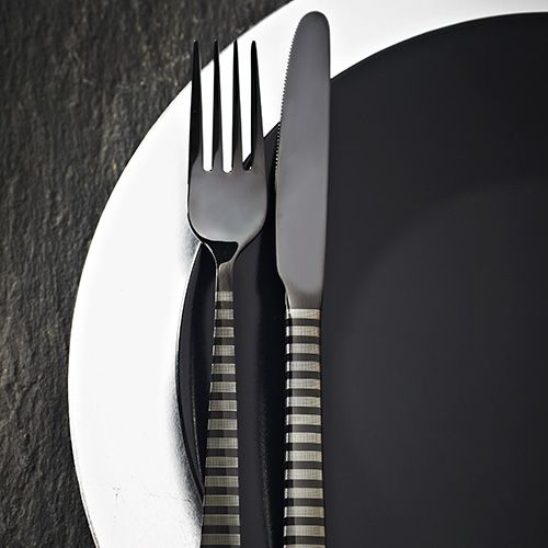 4 x Table forks (208mm) 4 x Table knives (230mm) 4 x Dessert spoons (185mm) 4 x Tea spoons (148mm)  Viners High Fashion Eminence Black 18/10 Stainless Steel Cutlery - with over a century of cutlery manufacturing experience, Viners is highly distinguished, trusted and much loved cutlery brand, steeped in British Heritage. Viners origins date back to Sheffield in the early 1900s, since then Viners have maintained a tradition which combines best in class materials and cutting edge technolog...