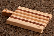 Traditional cutting board with handle.