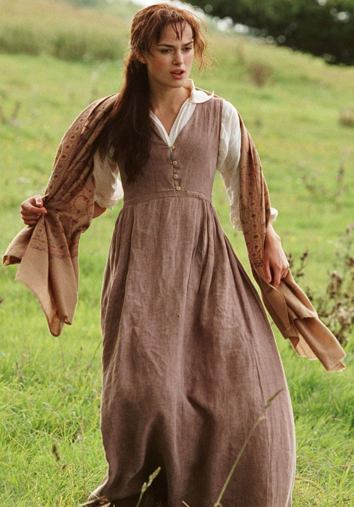 The brown jumper is worn over a long, puffy-sleeved blouse with a large, unclosed opening. It has a lower waist, higher in the front than back, with gathering and pleats in the skirt. The top has four loops and buttons holding it closed. From the movie Pride & Prejudice (2005.)