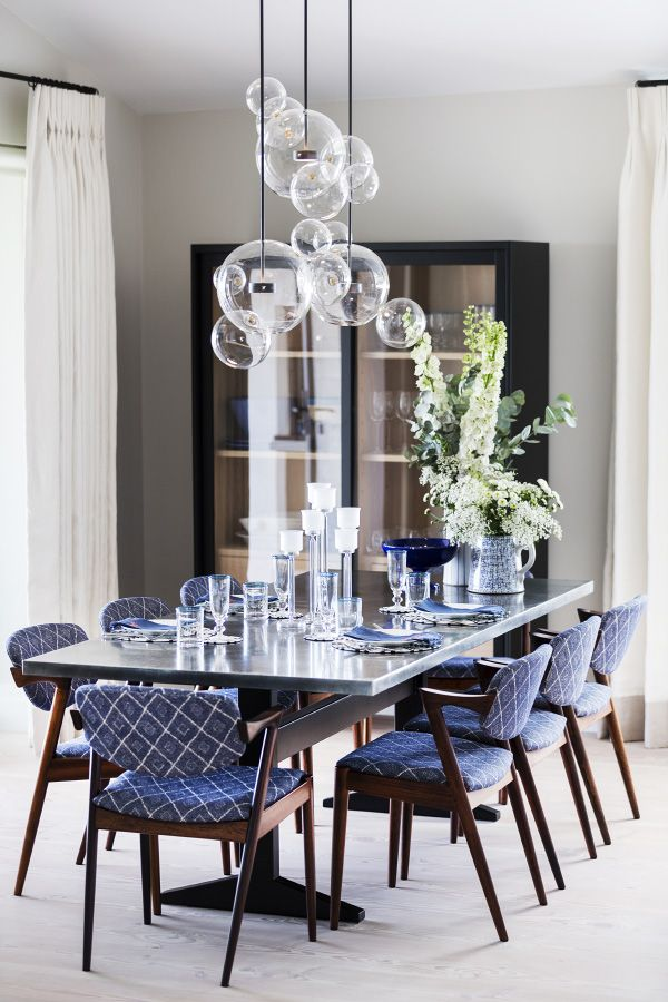 In the Capestang home's dining room, Giopato & Coombes's Bolle chandeliers hang over a zinc and black-metal dining table Ashby designed.