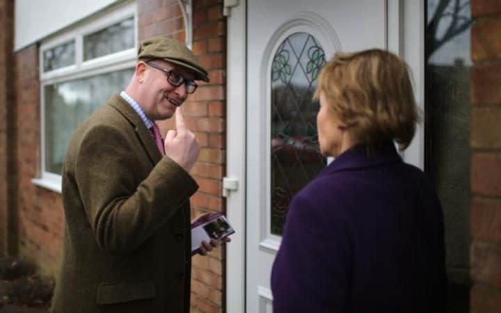 Independent Party (UKIP) election candidate Victoria Ayling and UKIP party leader Paul Nuttall canvas for votes in residential Hykeham ahead of the Sleaford and North Hykeham by-electionin Lincoln, England