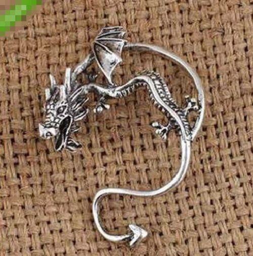 Mono orecchino singolo drago fantasy tono argento celtico celtic earring                                                                                                                                                      Más