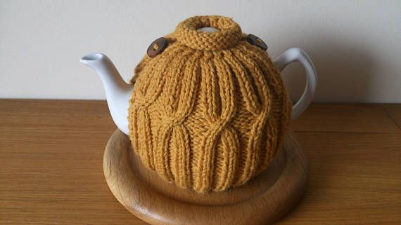 Golden Yellow hand knitted tea cosy with wooden button detail
