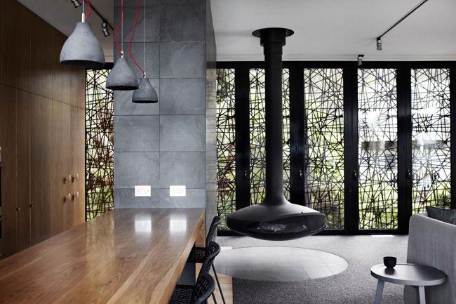 Maison contemporaine bois et béton ouverte sur l\'extérieur ...