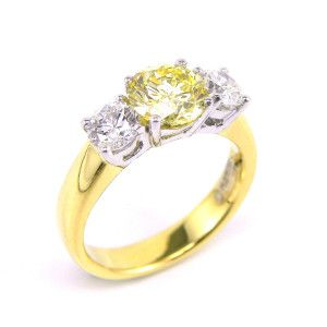 Three-diamond ring in 18ct yellow & white gold, featuring natural fine white and fancy yellow round brilliants. #Engagement #Rings #Sydney #fancy #Diamonds