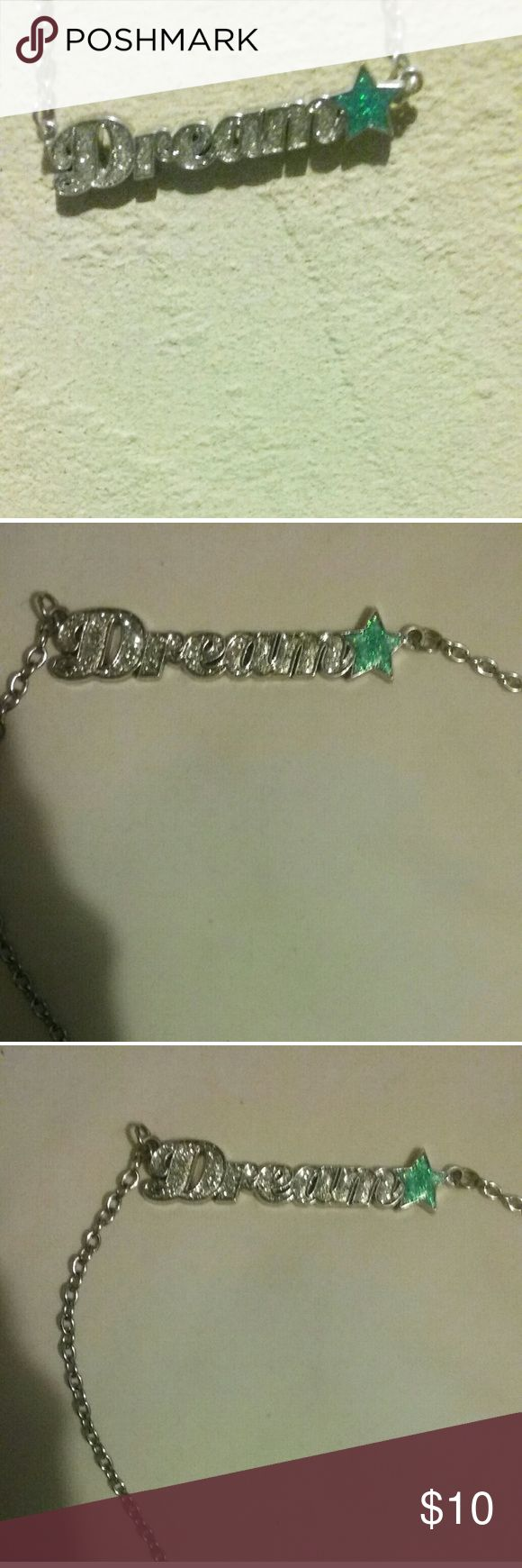 Turquoise and silver necklace Very cute silver necklace that spells dream with a turquoise star. The letters have sparkles and the star has a glitter look, very shiny type necklace. No flaws and intact, perfect and neat condition!   Goes with almost any outfit and on any occasion! The best wear for summer and or on a sunny day. Rue21 Jewelry Necklaces