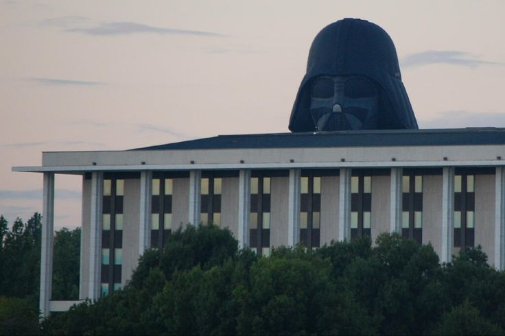 Canberra's centenary celebration, a Darth Vader hot air balloon floats over the Australian National Library