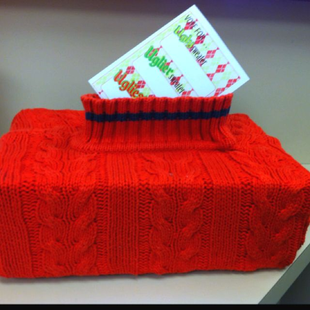 Voting box for ugly sweater party-- my own creation actually!  Bought a ($3) sweater from Goodwill and wrapped an old shoe box inside of it.  Cut it to fit and hot glued down the sides like a gift.