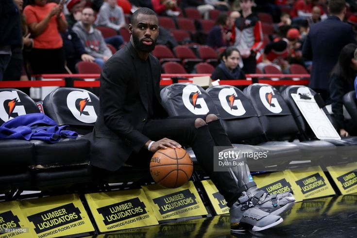 Tim Hardaway Jr. #3 of the New York Knicks dribbles a ball while sitting on the bench before the game against the Chicago Bulls at the United Center on December 9, 2017 in Chicago, Illinois.