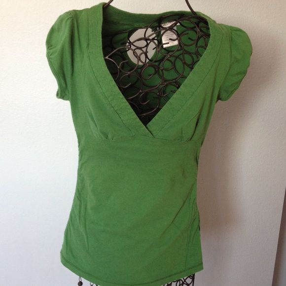 Rocker Girl Green short sleeve top Green short sleeve top with deep v neck cut, slight gathering under bust seam and slight gathering on side seams. Cut out on back. Good condition.. 100% cotton. Size is junior large. Rocker Girl Tops Tees - Short Sleeve