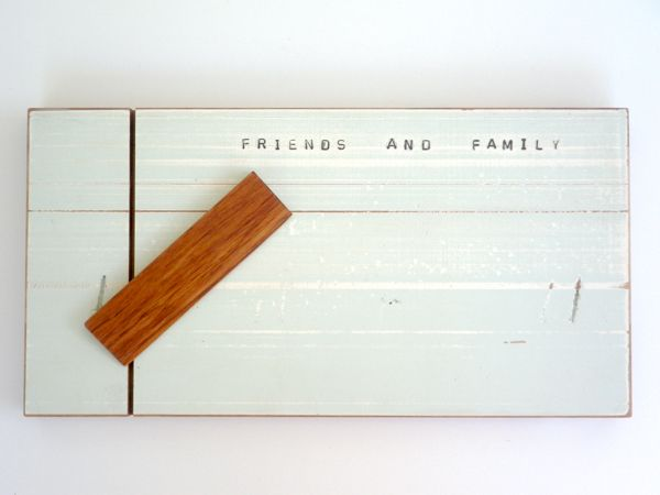 """Friends and Family Cheese Board New Zealand designware, recycled rimu lovingly made into beautiful cheese boards with wooden cheese knife. Distressed paint and the stamped words """"FRIENDS AND FAMILY"""" make these a delicious addition to the kitchen, both sides are useable, the reverse side has a natural wood finish."""
