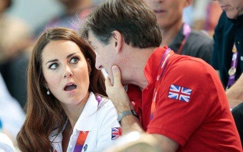 The Duchess of Cambridge and team GB ambassador Robin Cousins watch the Women's Teams Synchronised Swimming Technical Routine on Day 13 of the London 2012 Olympic Games © Adam Pretty/Getty Images