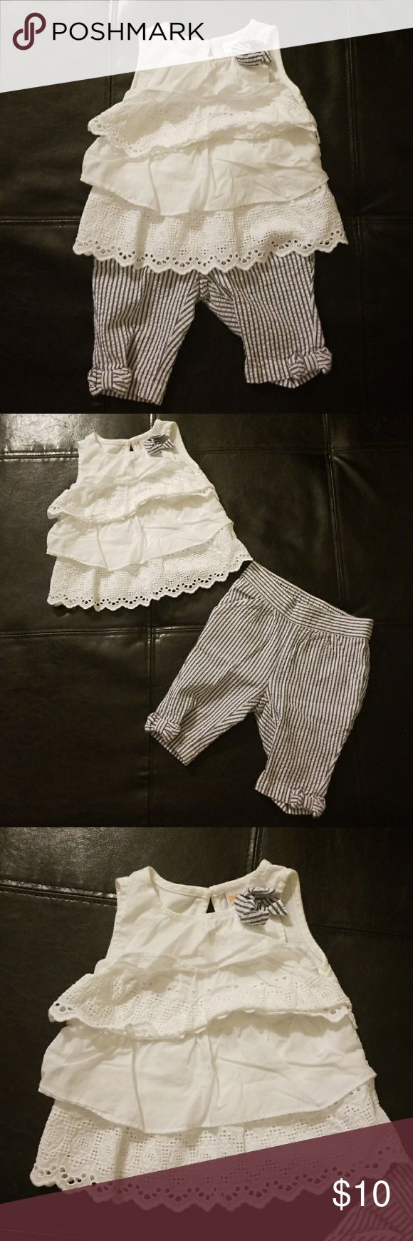 Gymboree 2 Piece Outfit Seersucker Pants Gymboree 2 piece outfit in 6-12 months. Excellent used condition. Seersucker pants with ruffled, layered tank. Blue and white. Top has a bow on it to match the bottom, as well as, layers with cotton blouse fabric and eyelet detailing. Pet and smoke free home. (Bin 24) Gymboree Matching Sets