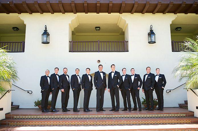 La Estancia La Jolla outdoor san diego wedding groomsmen wearing black tuxedos with black bow ties, groom and groomsmen at estancia la jolla wedding