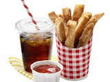 """April Fools' Fries: Cinnamon-Sugar Sticks - These french fry look-alikes are really fried breadsticks rolled in cinnamon and sugar. Their fruity """"ketchup"""" - strawberry jelly - is a perfect dipper."""