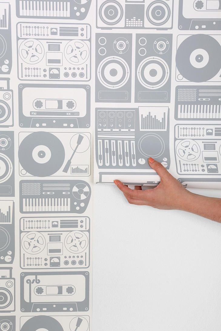 This wallpaper featuring music, tapes, speakers, record players, etc. is busy enough that I would put it in a small place like the inside of an armoir, a powder room, bar backsplash, or storage area.