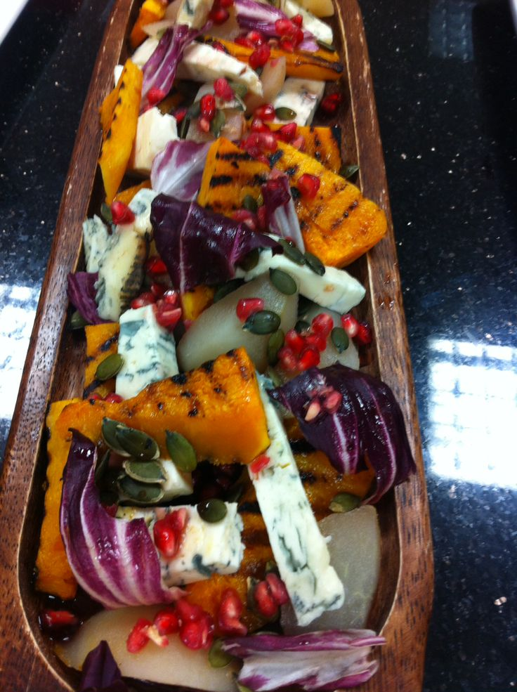 Salad of grilled butternut squash, gorgonzola, poached pear and a maple & pomegranate dressing