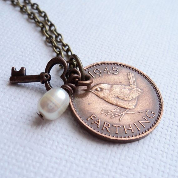 This necklace is handmade using a genuien British jenny wren farthing coin. It also has a charm made of a rice shaped freshwater ivory pearl and