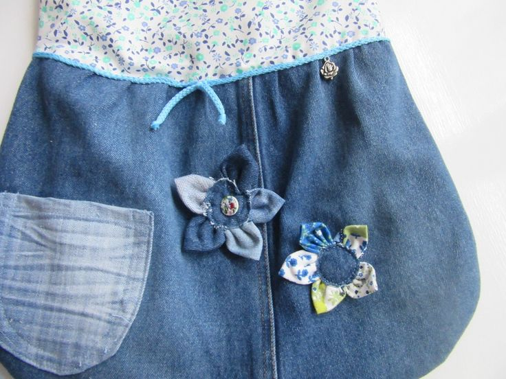Each shoulder bag is independently design no massive production only one of the kind. Made from recycled a light blue jeans with flowers liner with one pocket outside and one large pocket inside. Cell phone , iPad , Blackberry, mobile phone pouch is fully lined and padded and has a snap closure.