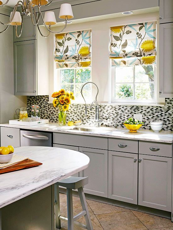 Curtains or shades is a fun, inexpensive way to put color into your kitchen. Pick a fabric that you love, with a proportionate pattern to your space (large pattern in large kitchen, smaller pattern in a smaller kitchen). Try to pick fabrics that are easy to wash. Have Fun with Fabric