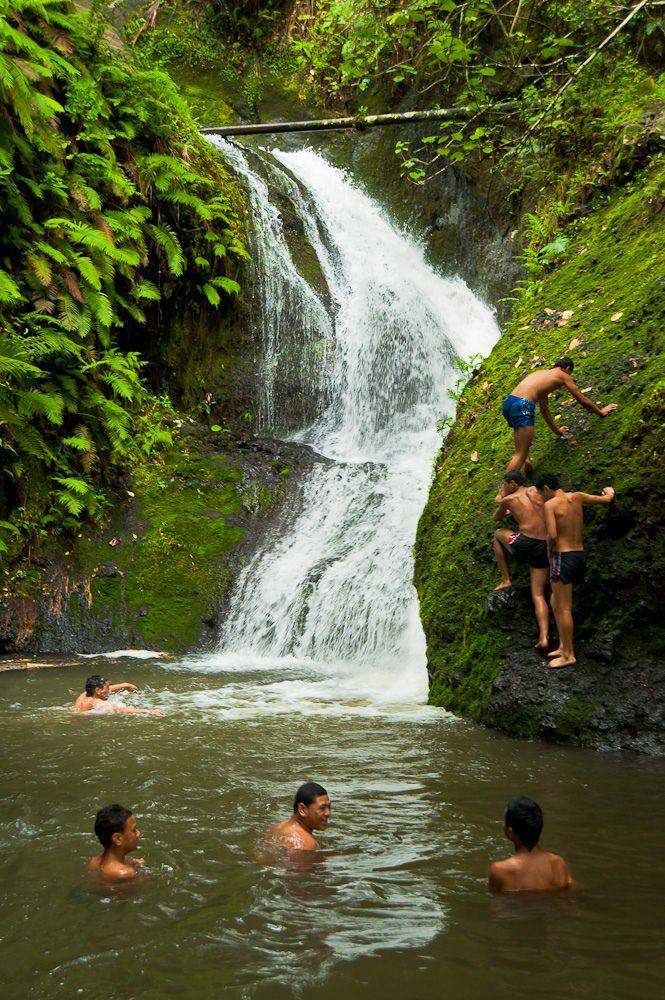 Wigmore's Waterfall (Rarotonga - Cook Islands) | Local kids enjoying Wigmore's Waterfall following a night of heavy rain.