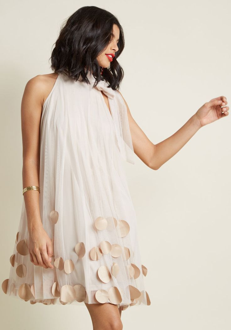 This lovely beige dress by Ryu will have everyone at your garden tea party talking! Layered atop a comfy lining, light mesh flaunts the satiny, circular...
